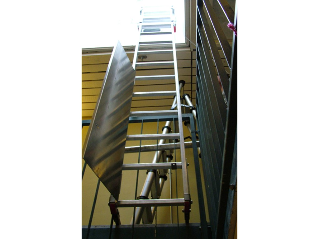 Fixed ladder for inspection of fire hatches